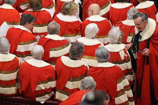 Peers wait in in the House of Lords for the arrival of Queen Elizabeth II, and Prince Philip, the Duke of Edinburgh, to conduct the State Opening of Parliament
