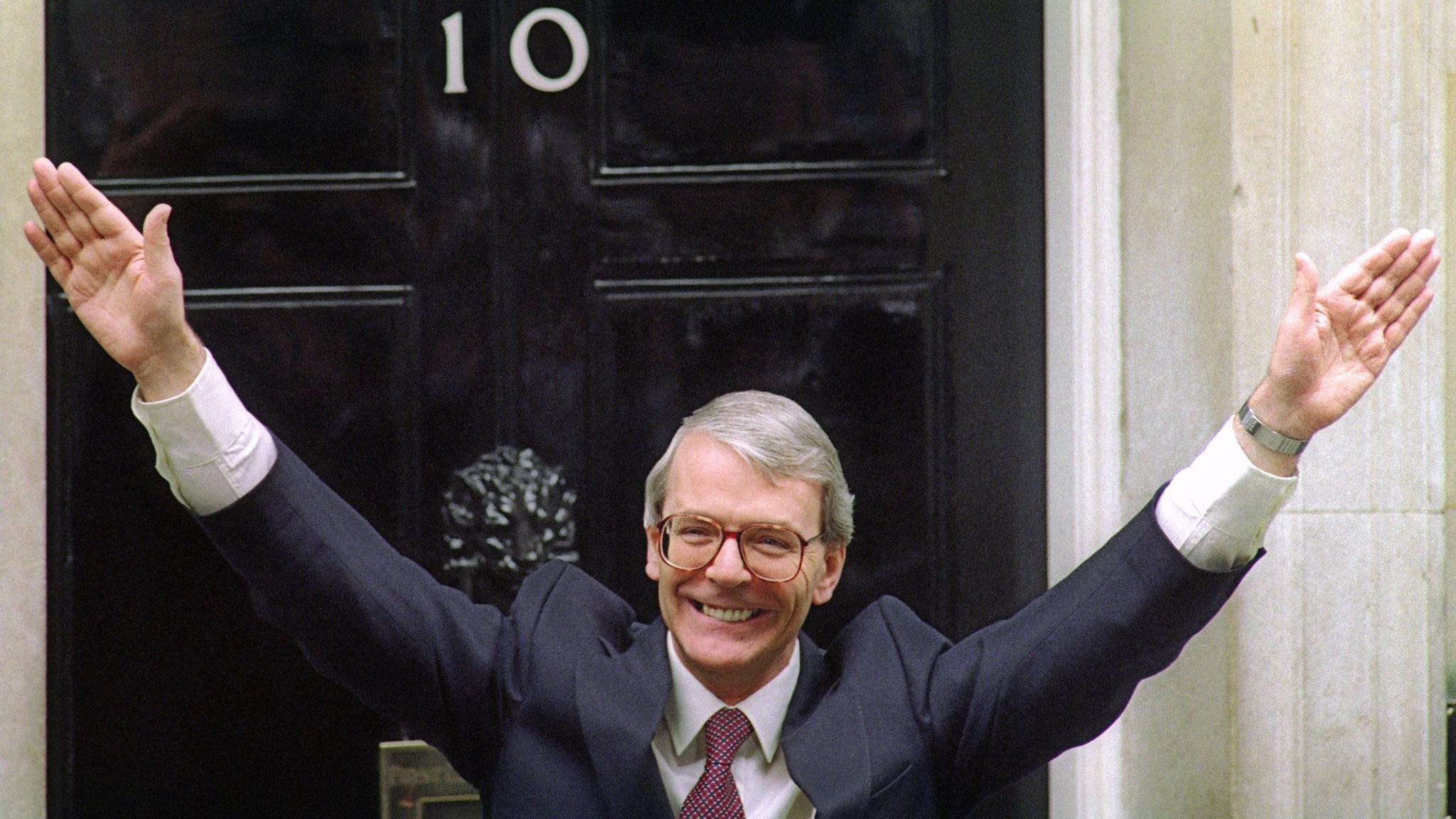 Britain's Prime Minister John Major waves to the c