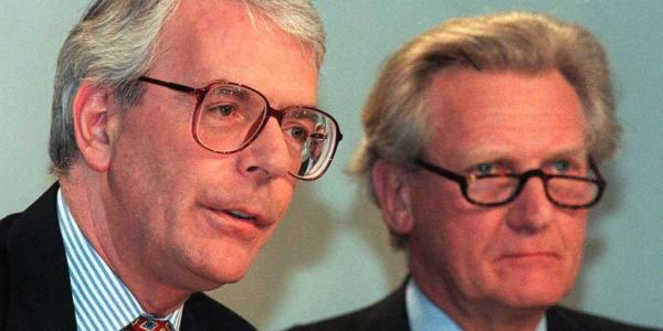 LONDON, UNITED KINGDOM - APRIL 9:  British Prime Minister John Major (L)  and  his deputy  Michael Heseltine answer questions at the morning election conference, 09 April in London,  as sleaze promised to dominate the 22 days left to May 1 elections after local party bosses thumbed their noses at the national leadership and retained   MP Neil Hamilton accused of taking bribes. Mr Major said that Mr Hamilton had the full support of the Conservative Party and hoped he would return to the House of Commons to carry out his work,    and he called on the voters of Tatton to stand behind    Hamilton and elect him as their MP at       elections.  (Photo credit should read JOHNNY EGGITT/AFP/Getty Images)